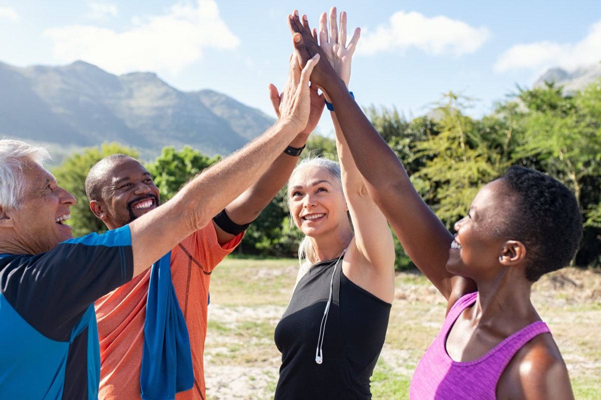 Group of friends exercising high five each other