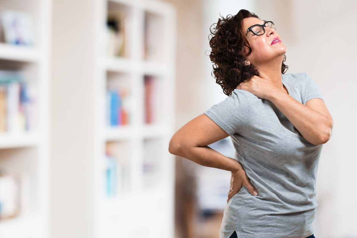 Woman with neck back pain