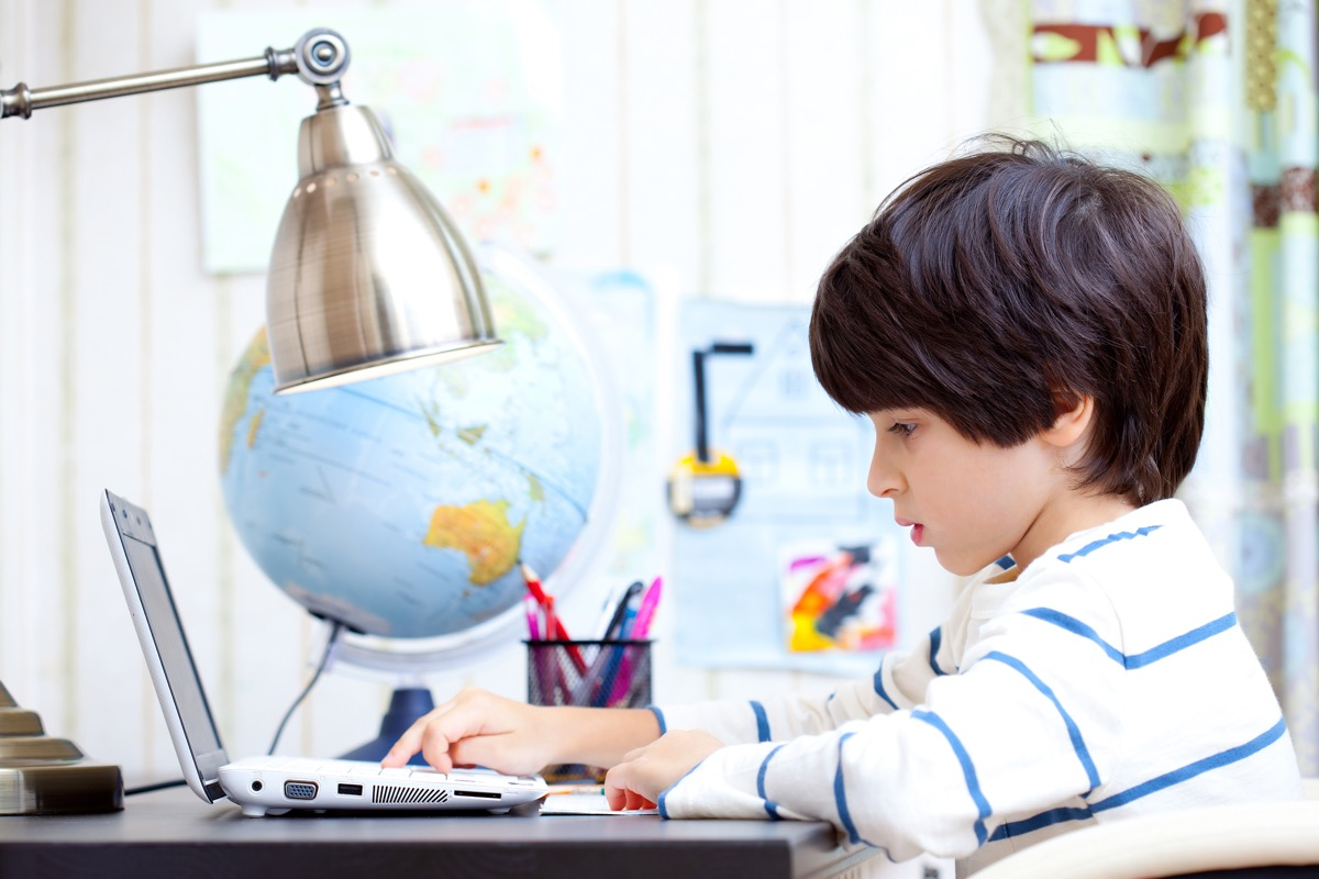 Child Doing His Homework on the Computer, ways parenting has changed