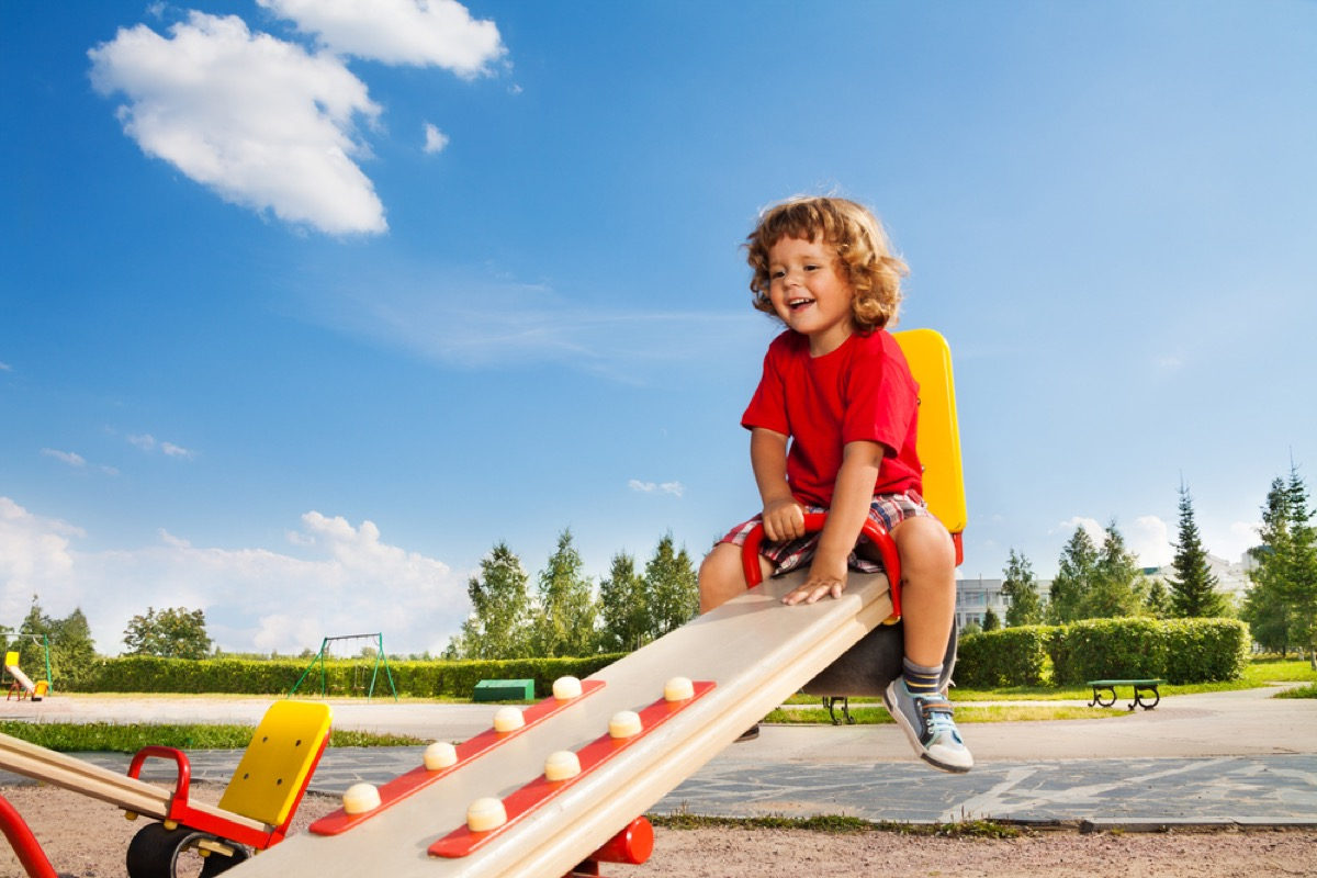 kids playing on seesaw at park, bad parenting advice