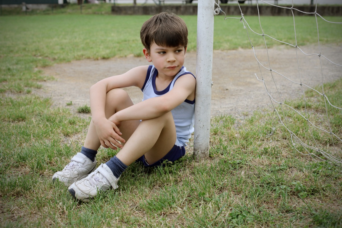 Sad Kid Playing Soccer, bad parenting