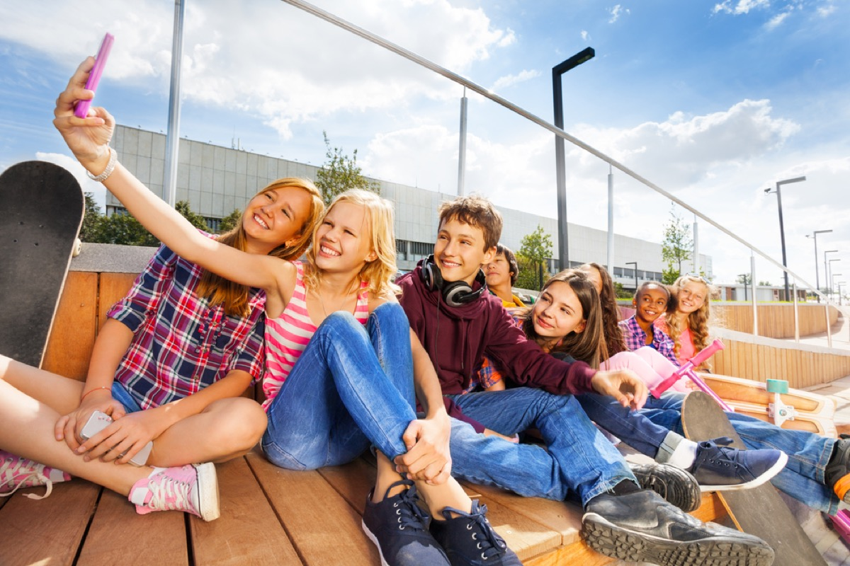 kids taking photo with cell phone, ways parenting has changed