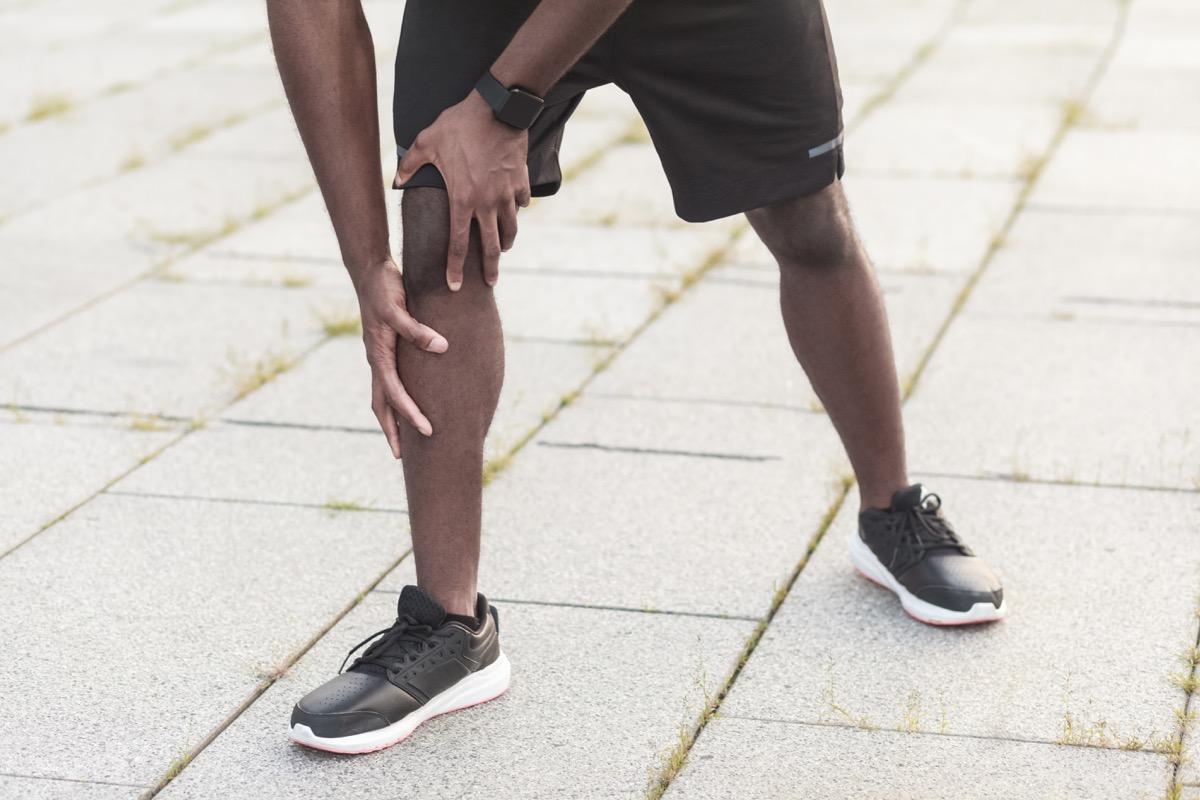 man experiencing leg pain while walking, heart warning signs