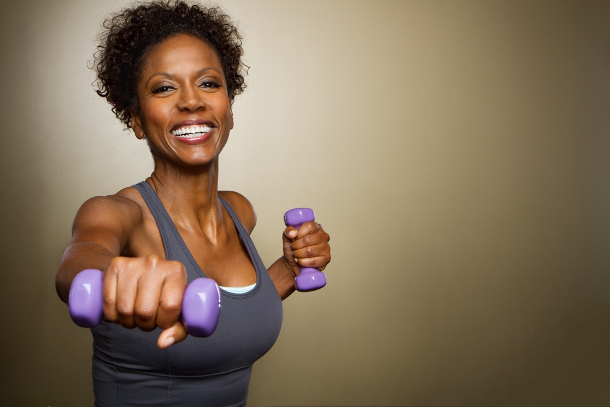 Woman lifting weights doing exercises