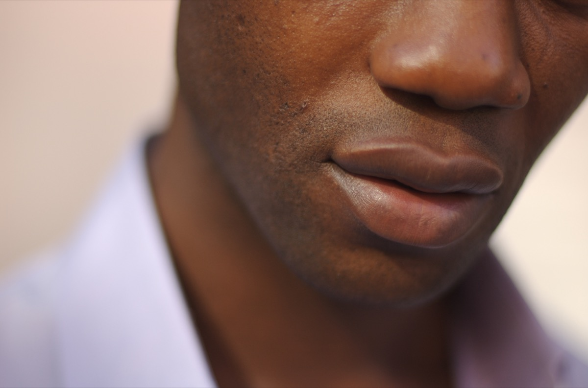 """""""Close-up of the lips of a male model, everything else in soft focus"""""""