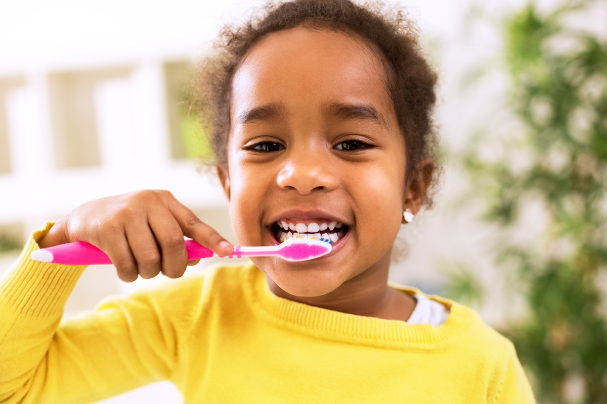 Little Girl Brushing Her Teeth Childhood Habits That Affect Health