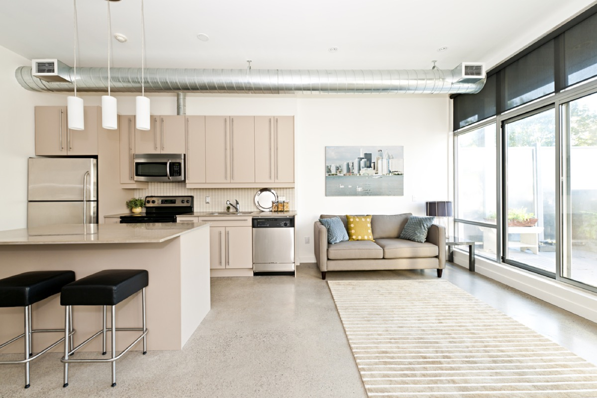 living room with concrete flooring, vintage home upgrades