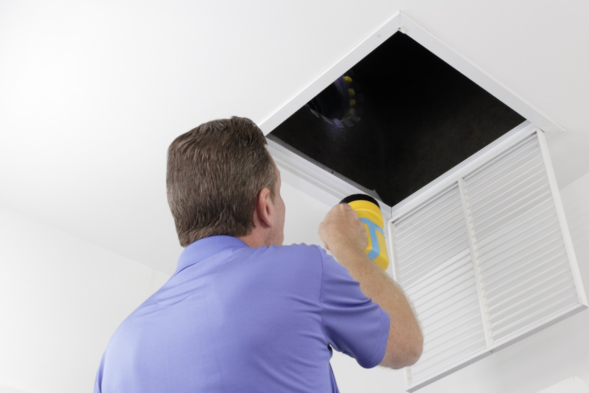 man doing hvac inspection ways to bring down a/c bill