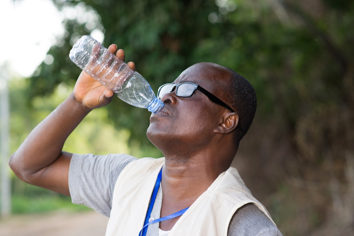 man drinking water after exercising, look better after 40