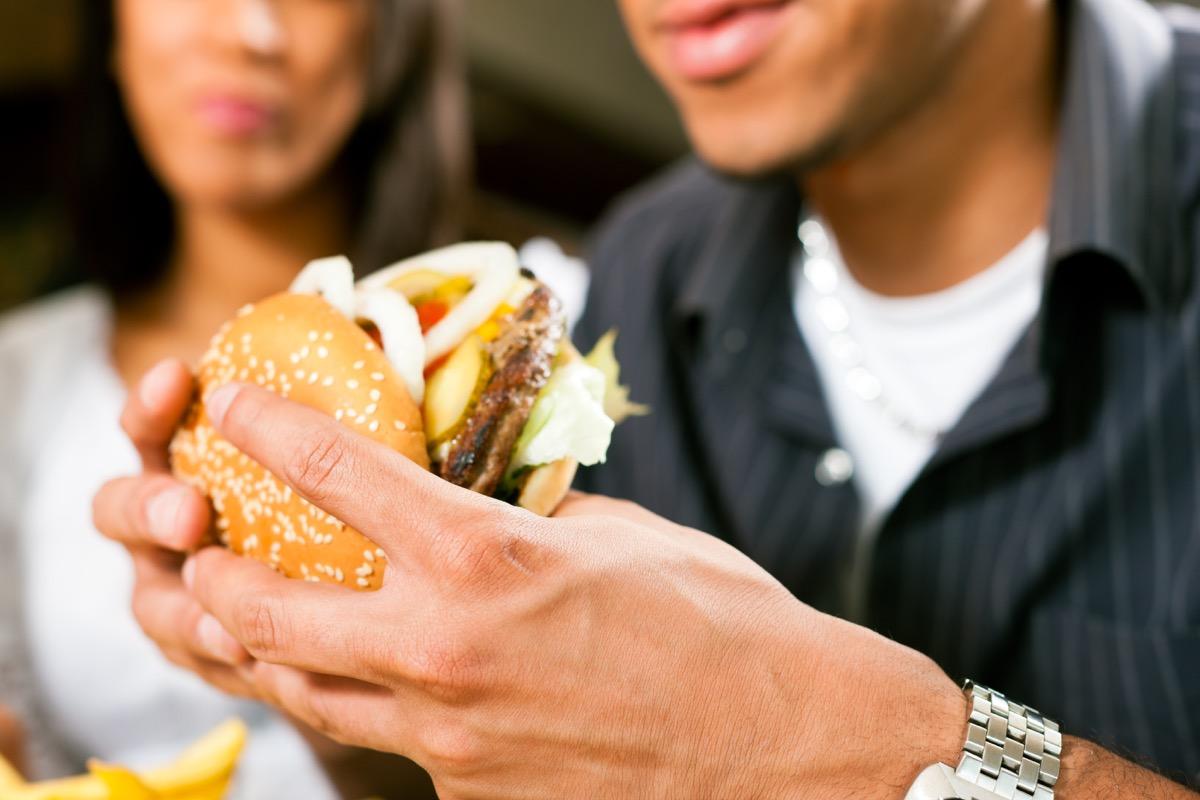 Man eating a cheeseburger