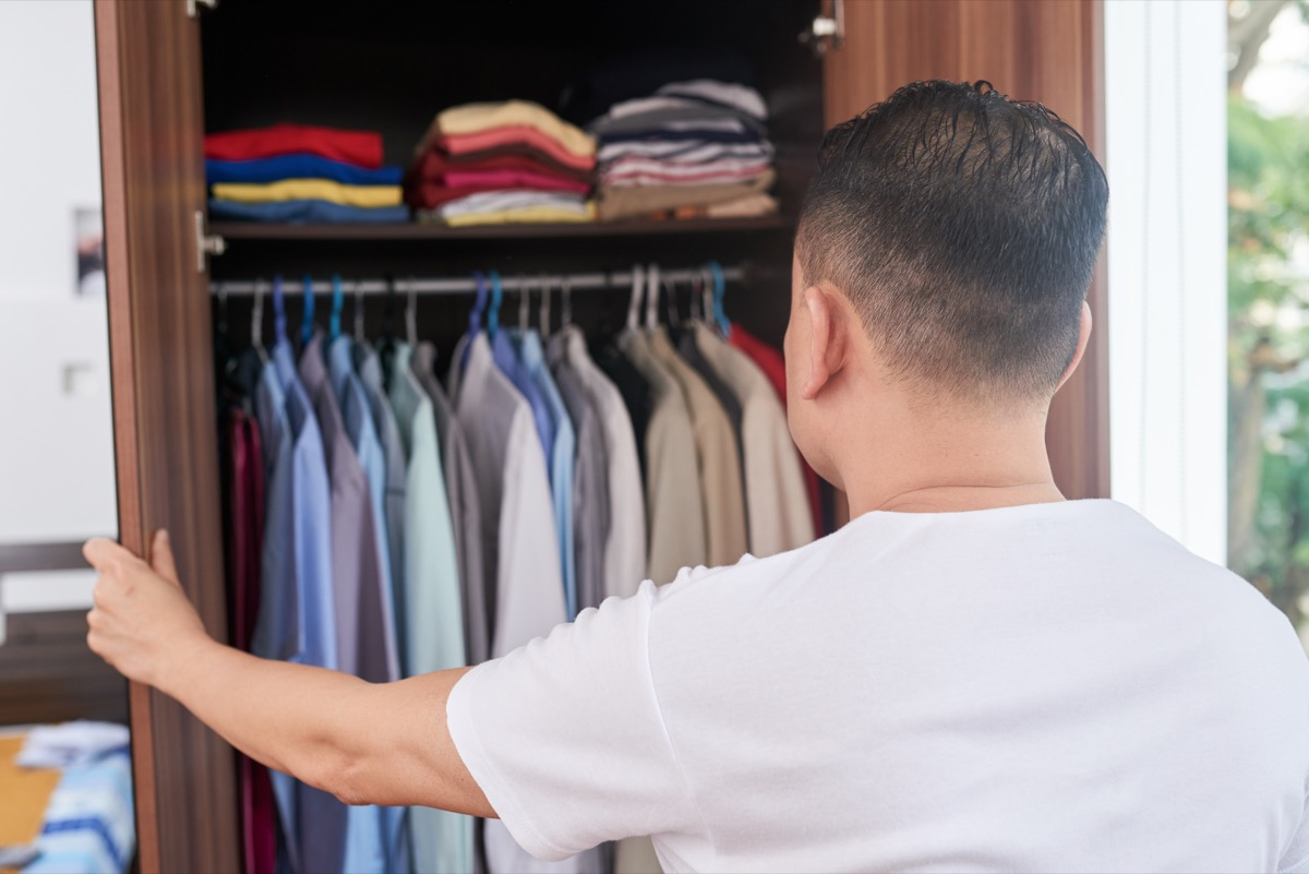 man looking in closet, downsizing your home