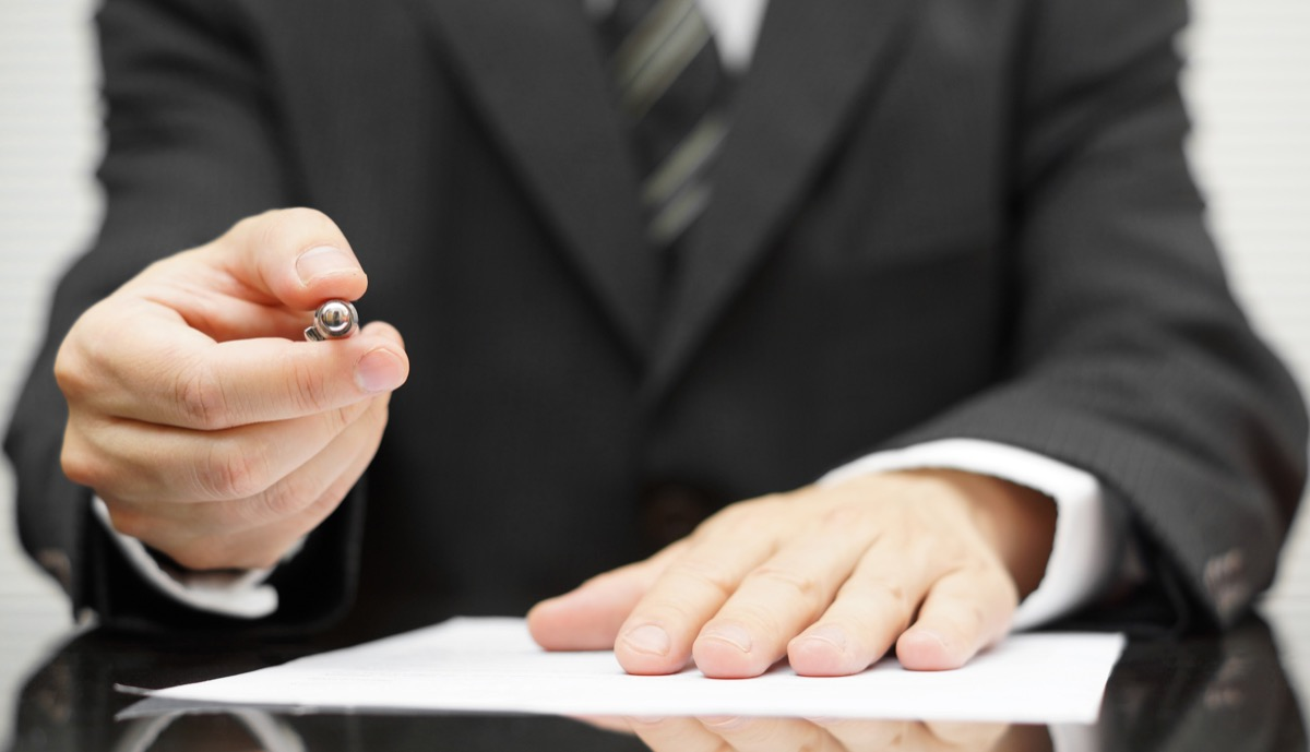 man holding pen to sign contract, dad jokes