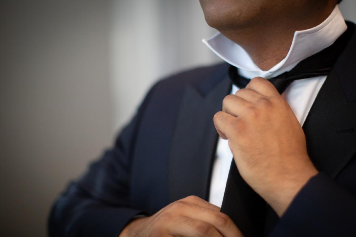 older man tying tie, look better after 40