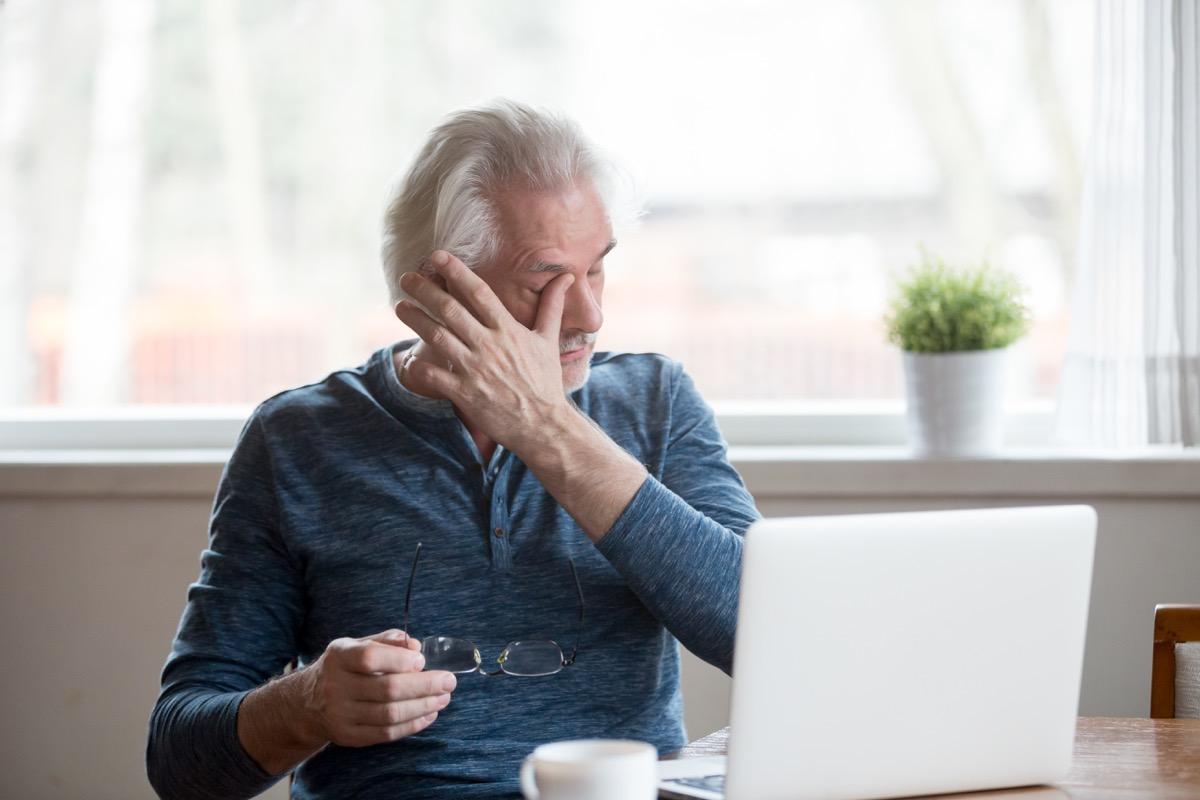 Older Man Rubbing His Dry Eyes Silent Health Symptoms