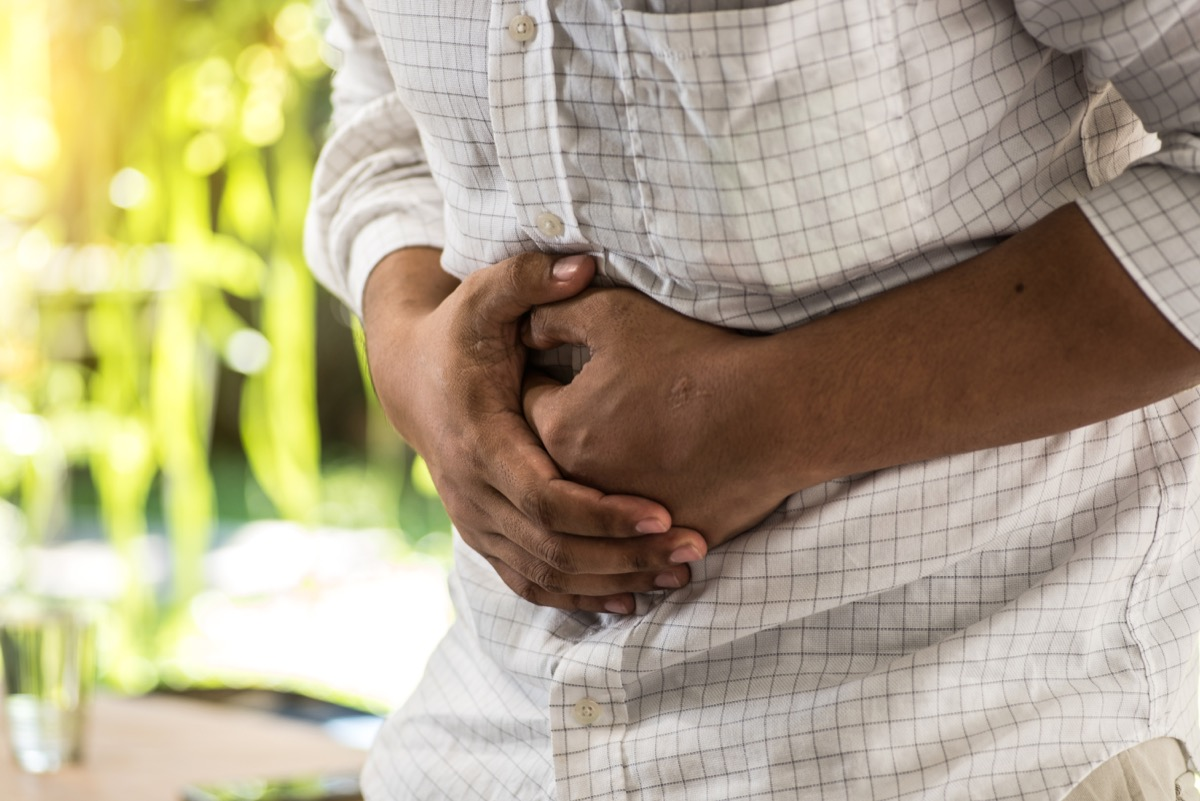 Man Holding His Stomach in Pain, health questions after 40