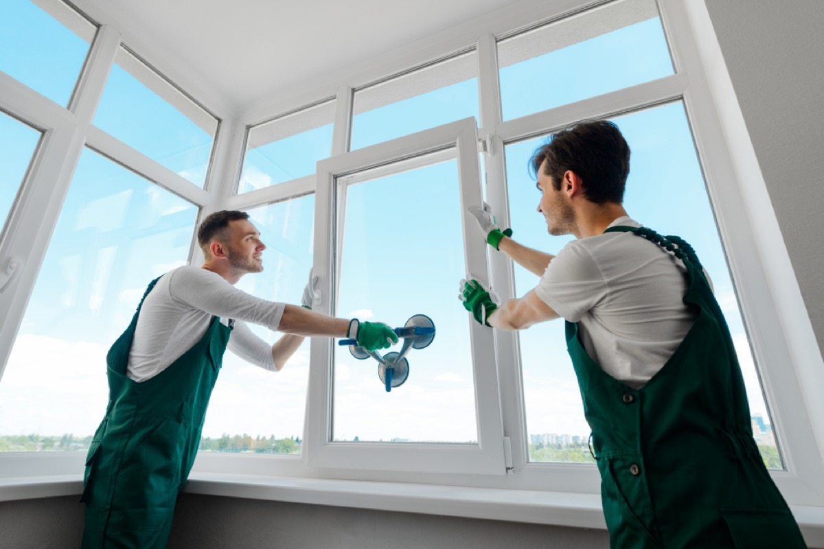 men installing new windows, home remodeling cost
