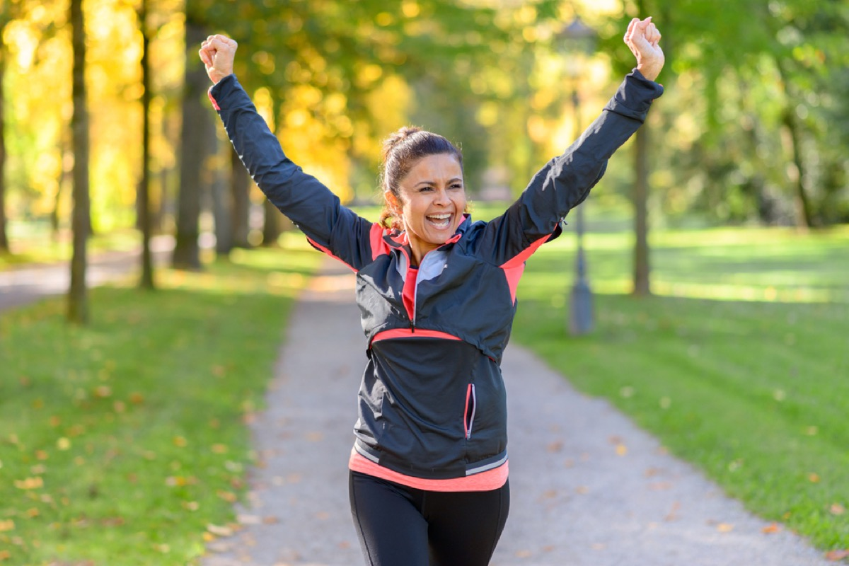 happy older woman jogging, look better after 40