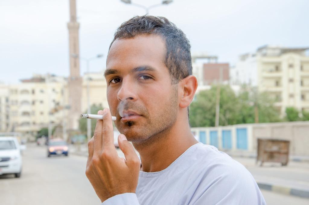 Muslim Man Smoking a Cigarette Ways Ramadan is Celebrated