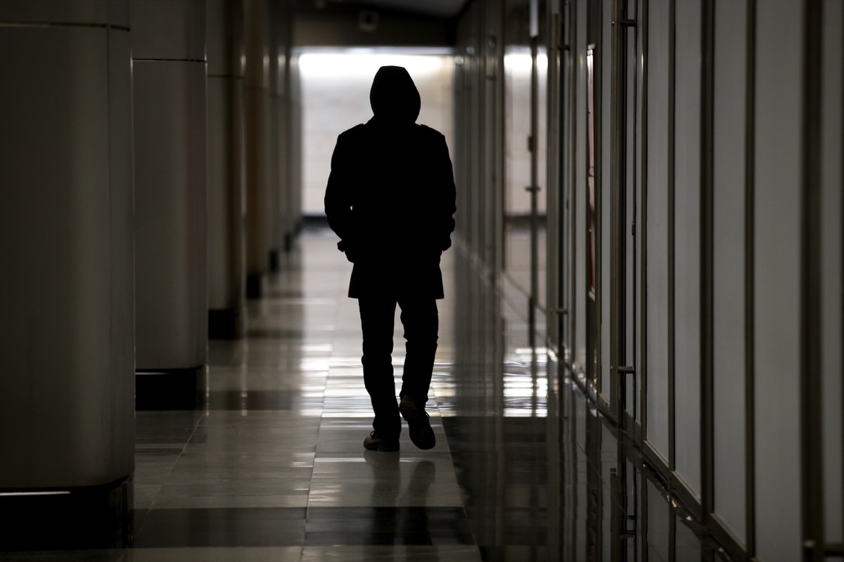 mysterious man in hallway, safety tips