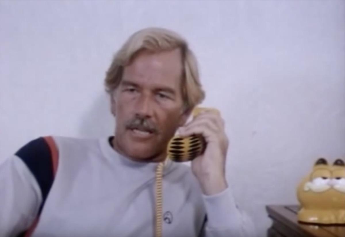 movie scene from ninja terminator, garfield phone, 1980s nostalgia