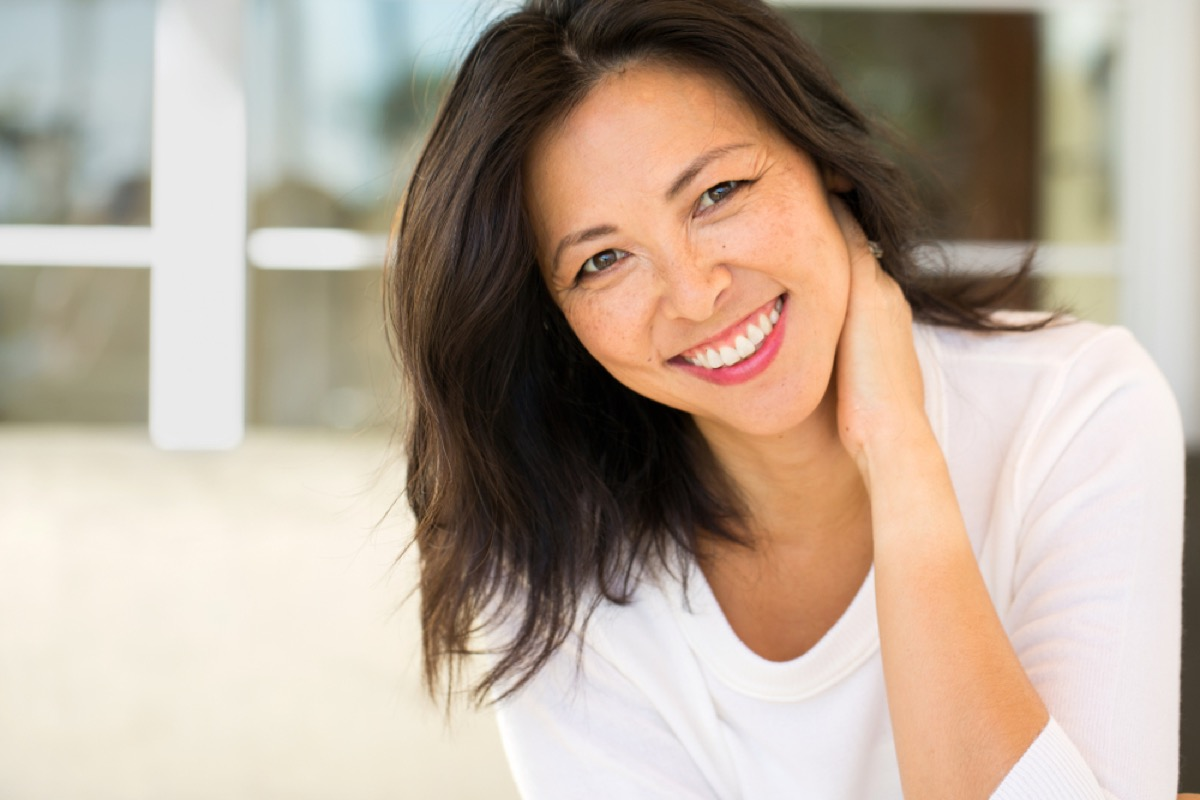 attractive middle aged woman outdoors, look better after 40