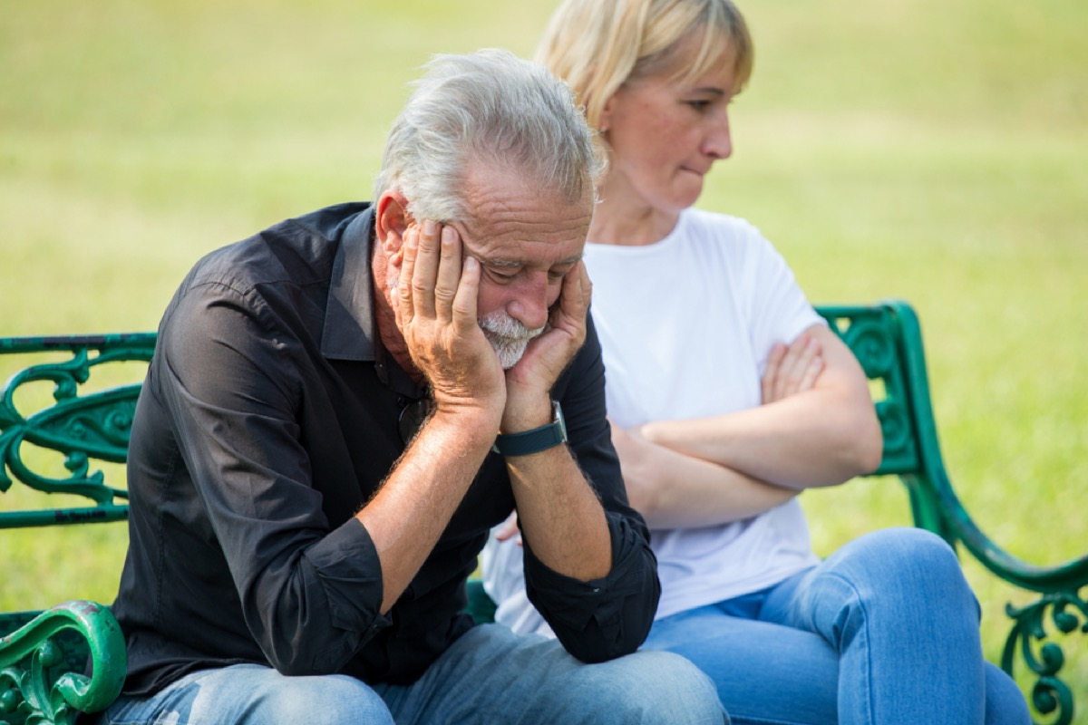 older couple fighting on a park bench, things you should never say to your spouse