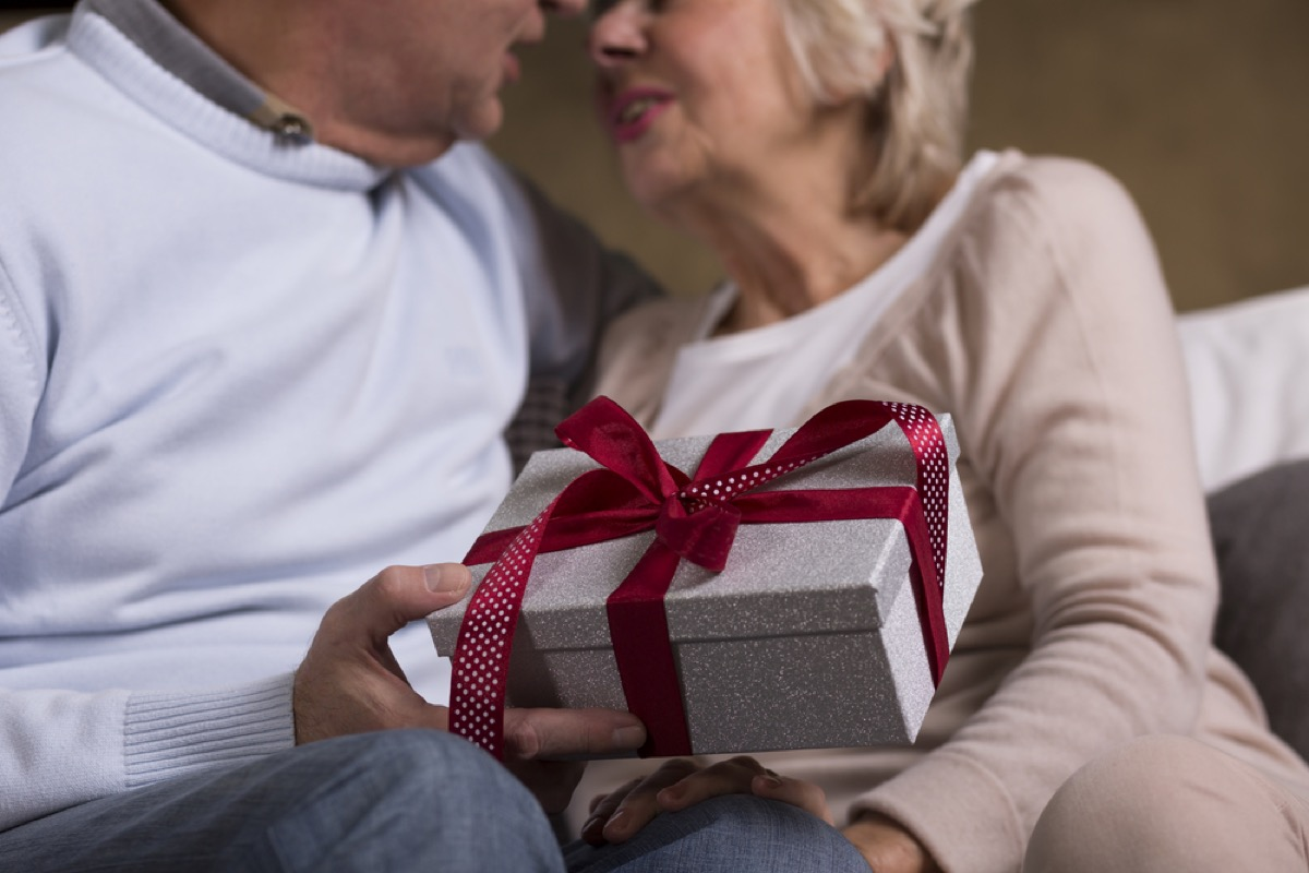 older couple exchanging gifts, relationship white lies