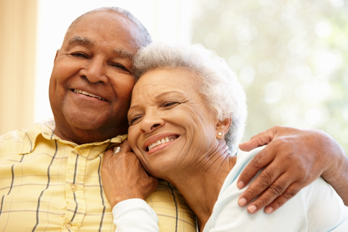 older black couple hugging, make yourself more attractive