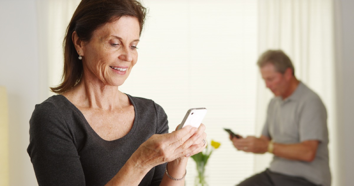older couple on smartphones, better wife after 40