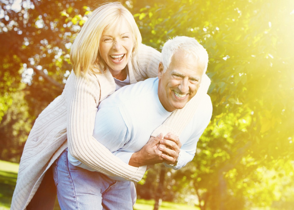 older couple doing a piggyback outside, better wife after 40