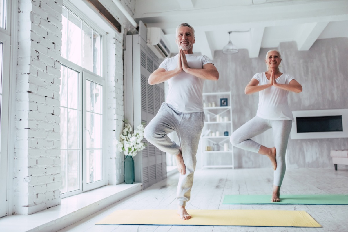 older couple in tree pose, better wife after 40