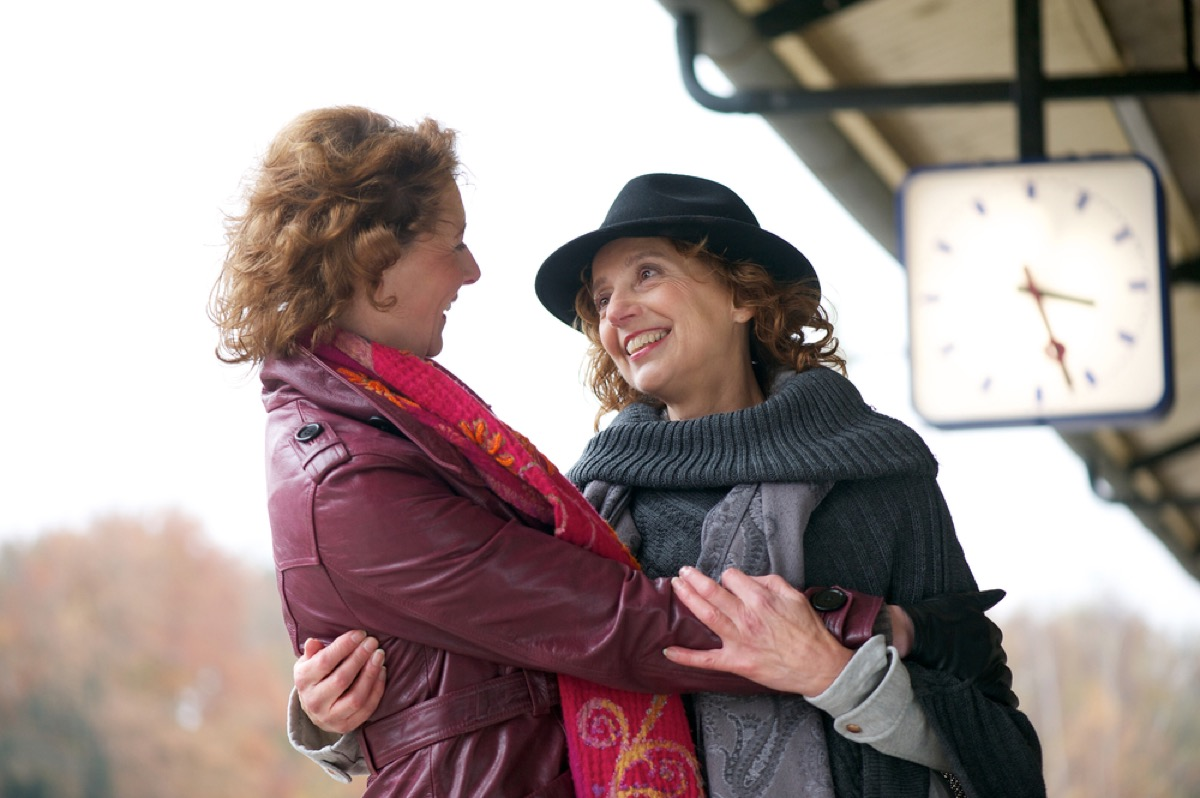lesbian couple holding each other, over 50 regrets