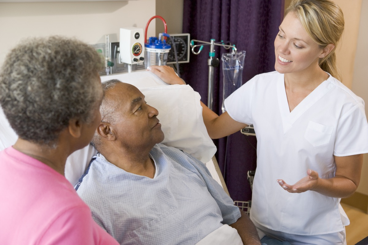older man talking to specialist doctor, health questions over 50