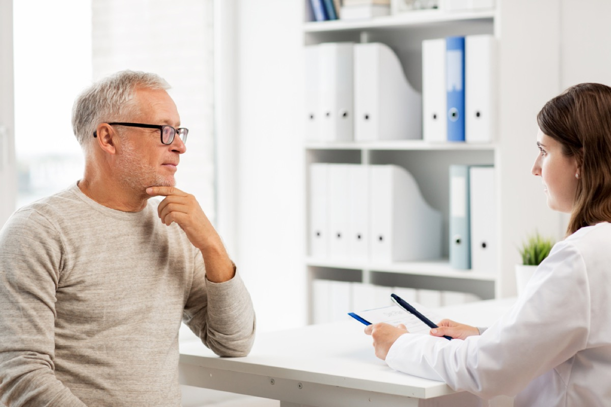 older man at checkup, health questions after 40