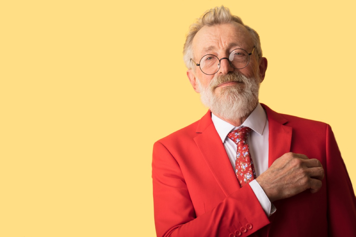 older man wearing red suit, look better after 40