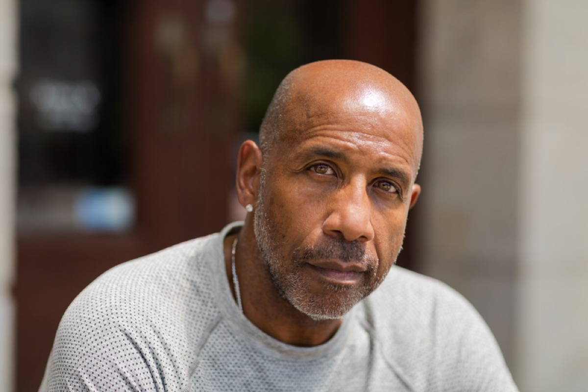 older black man with light stubble outdoors, look better after 40