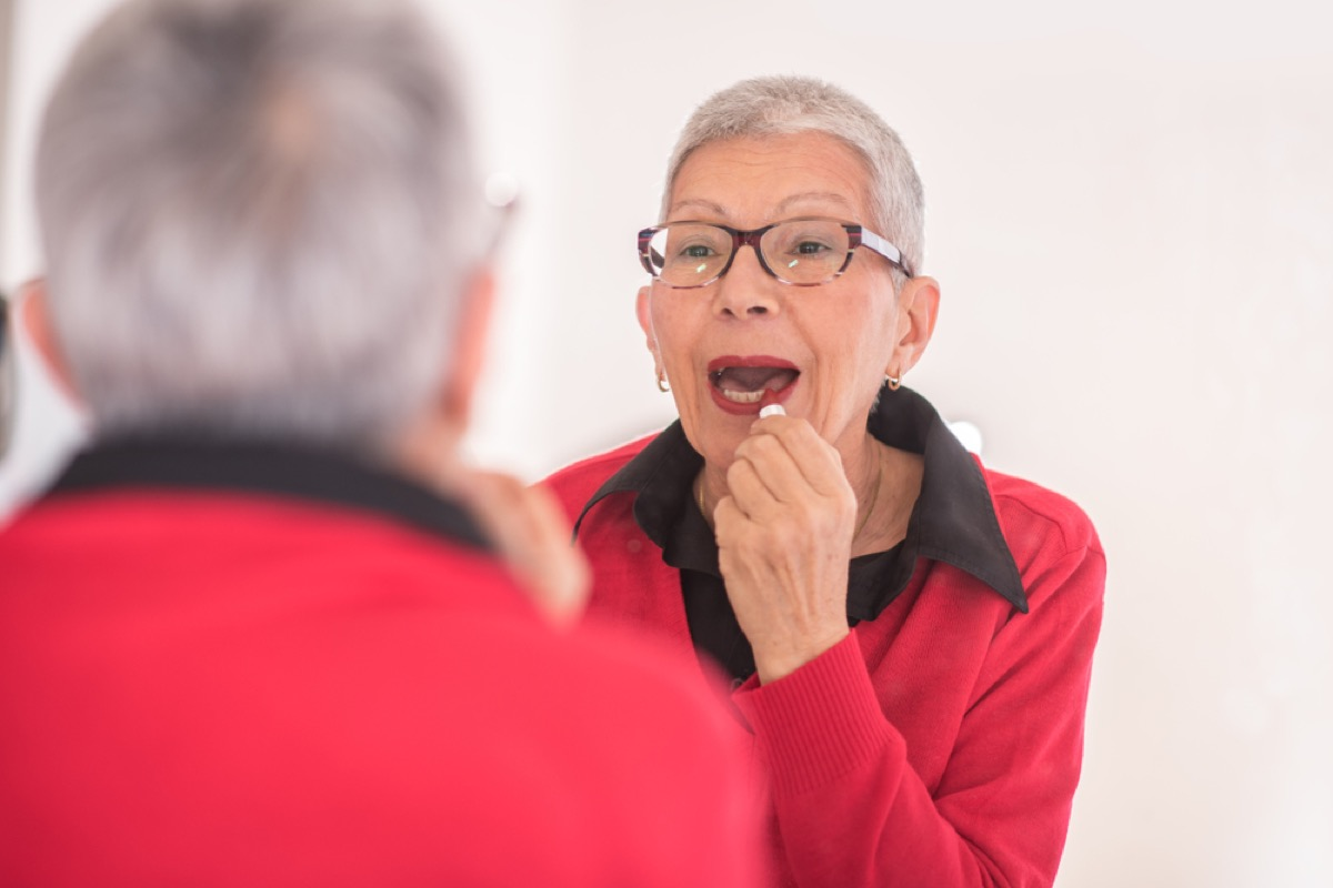 older woman wearing red lipstick, look better after 40