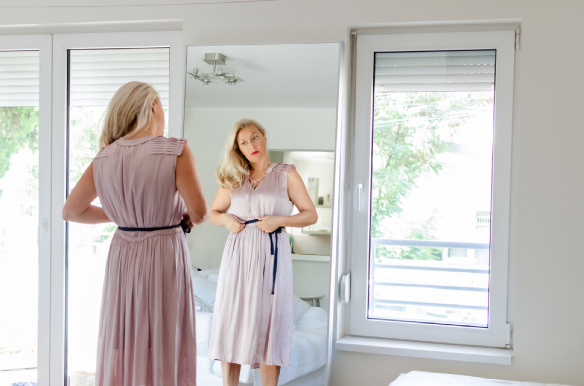 older woman dressing up in mirror, look better after 40