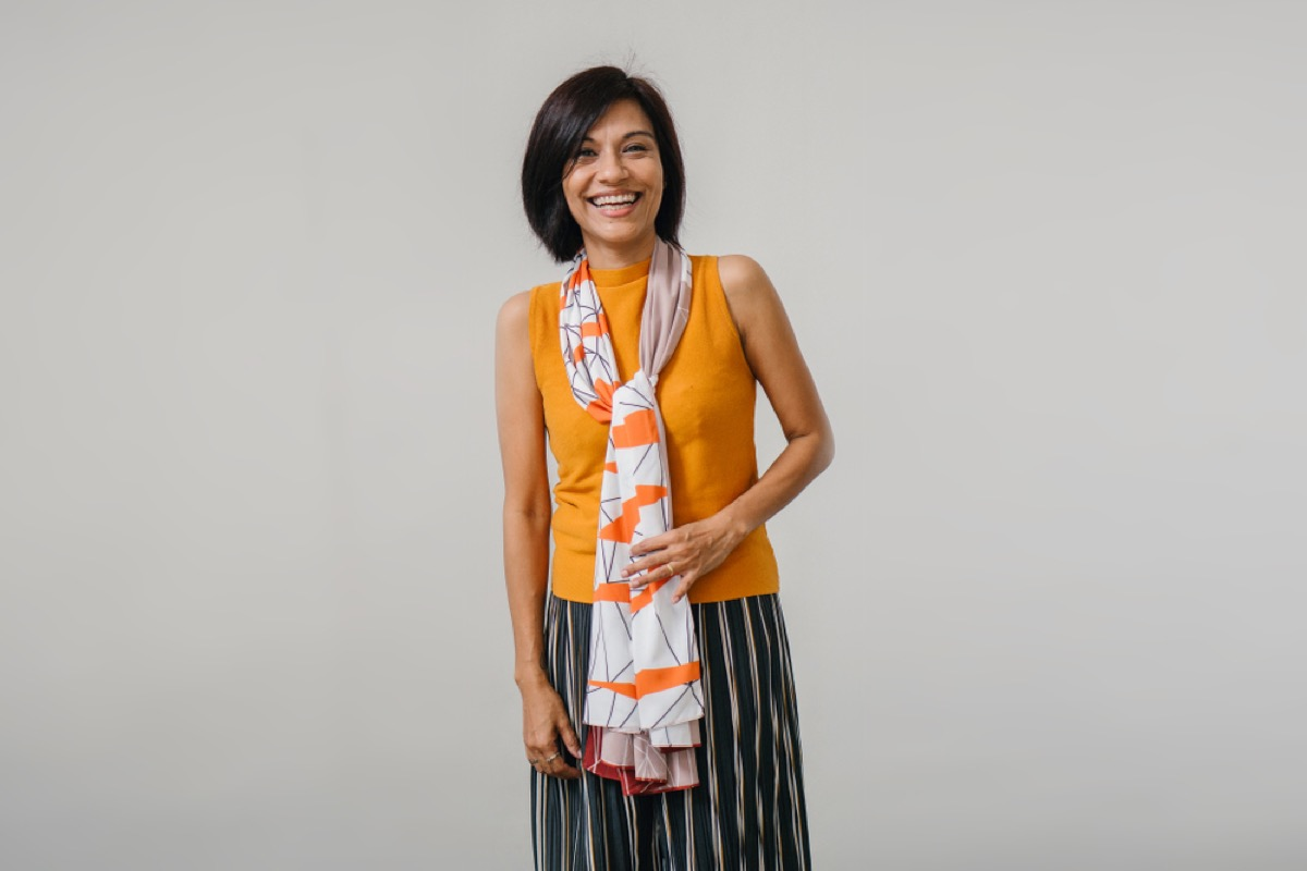 asian woman in fashionable clothing, look better after 40