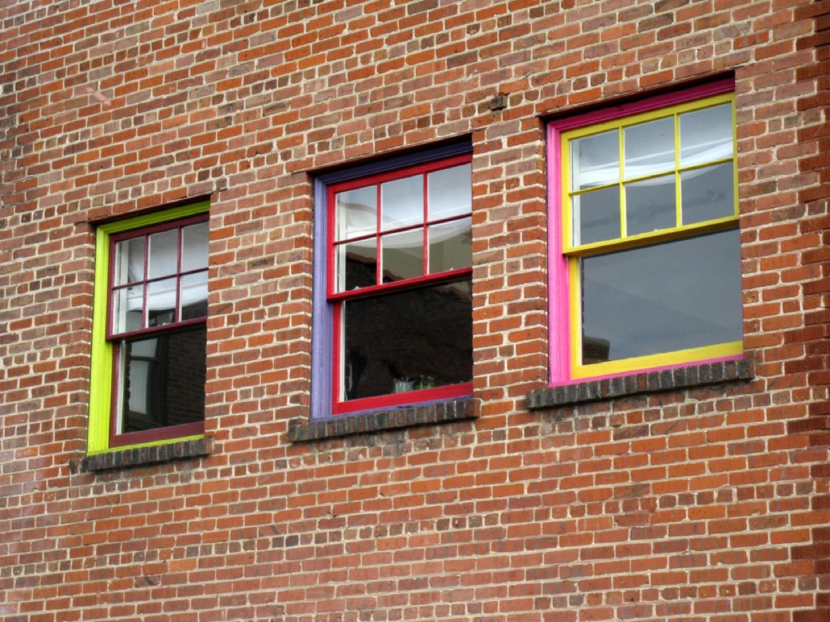 Colorful gridded windows on brick building