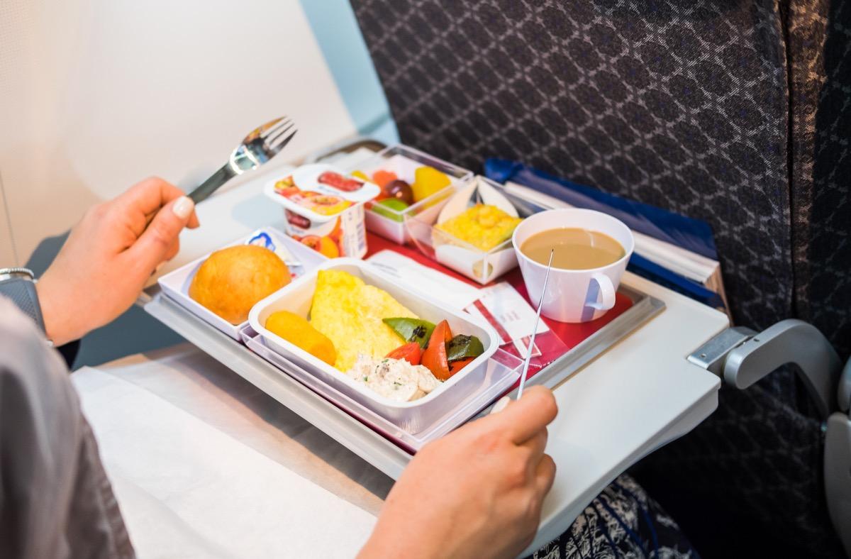 passenger eating food on airplane things that horrify flight attendants