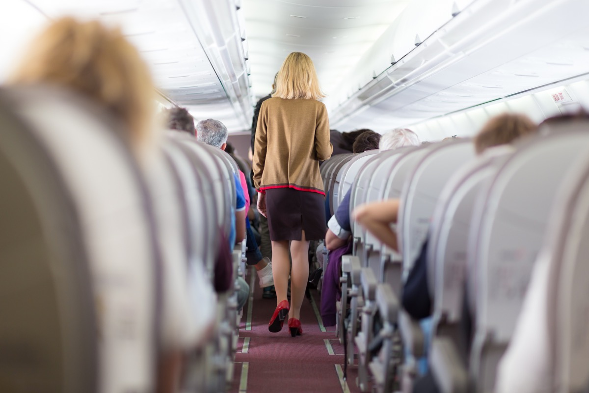 people crowding the aisle on airplane