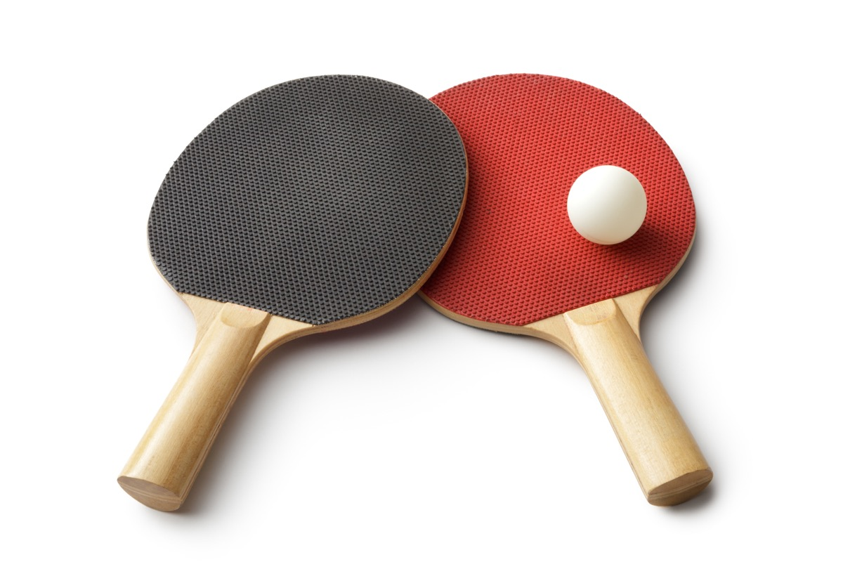 ping pong paddles on white background