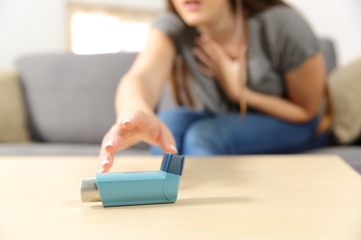 reaching for inhaler because of shortness of breath, heart warning signs
