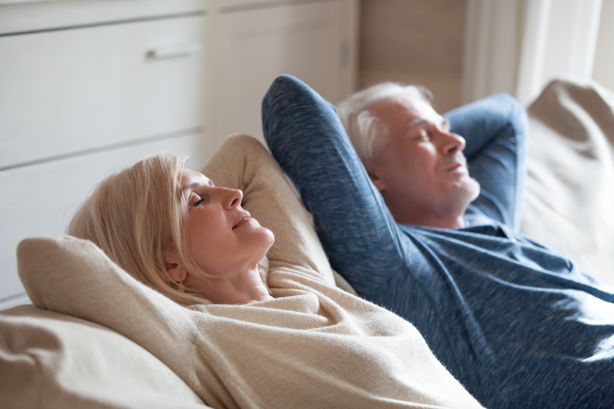 Older couple relaxing on couch
