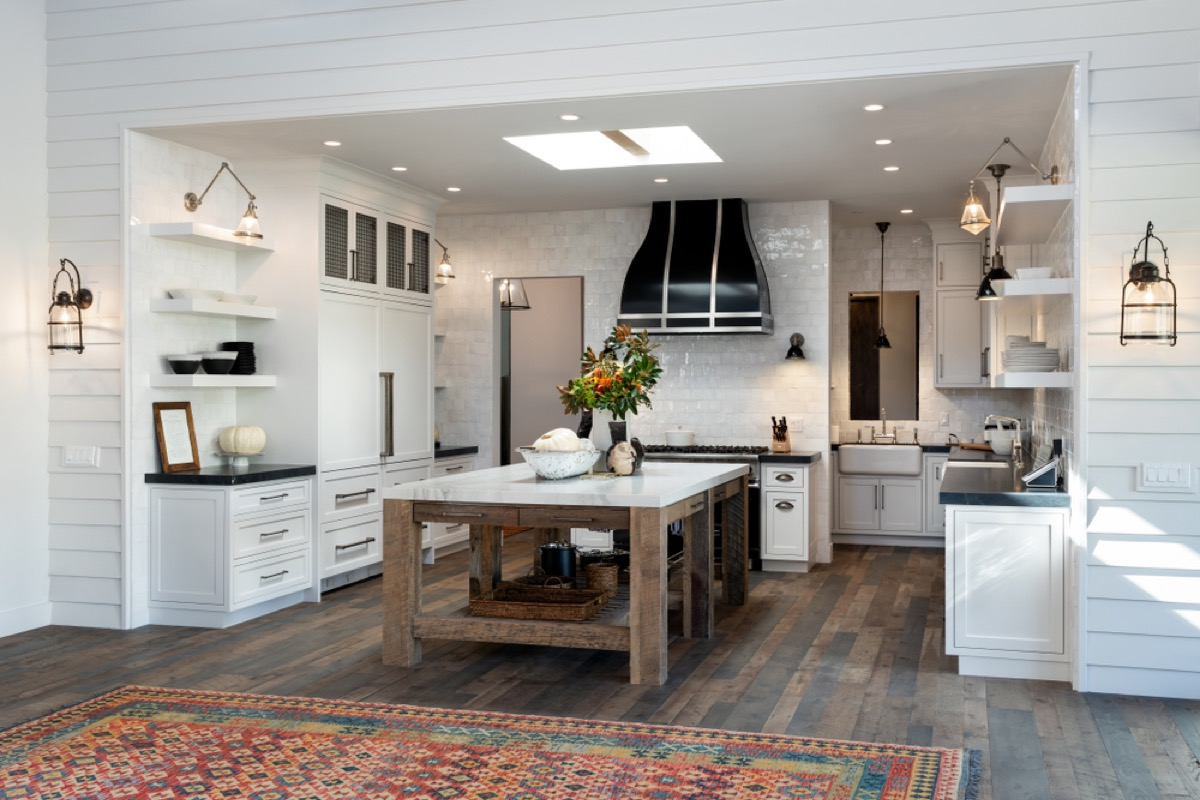 farmhouse kitchen with persian rug, joanna gaines tips