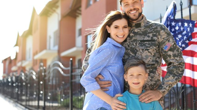 american veteran smiling with family after retirement.