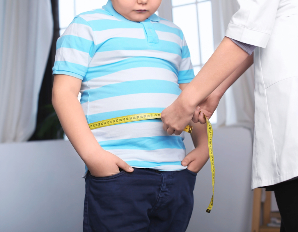 chubby boy being measured at doctor, parenting is harder