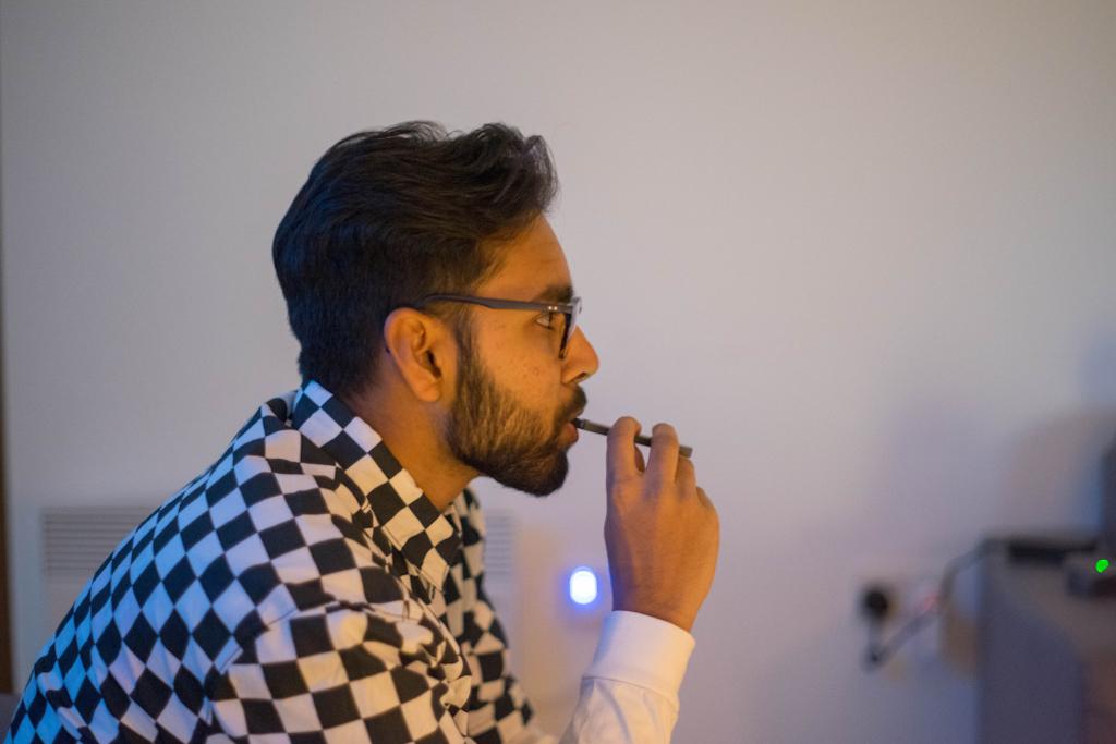 young man smoking JUUL