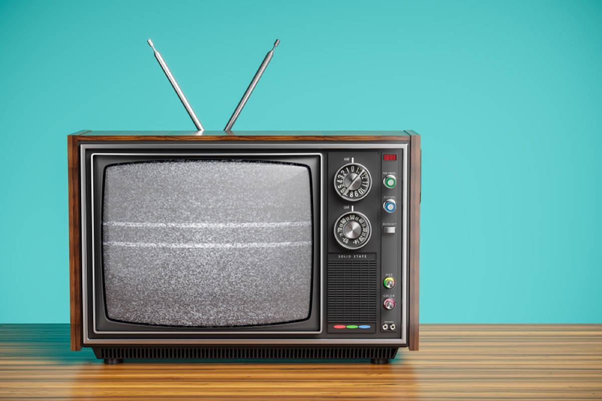 old tv with antennae and blue background